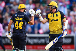Chris Cooke and Dan Douthwaite of Glamorgan touch gloves between overs<br /> <br /> Photographer Craig Thomas/Replay Images<br /> <br /> Vitality Blast T20 - Round 4 - Glamorgan v Middlesex - Friday 26th July 2019 - Sophia Gardens - Cardiff<br /> <br /> World Copyright © Replay Images . All rights reserved. info@replayimages.co.uk - http://replayimages.co.uk