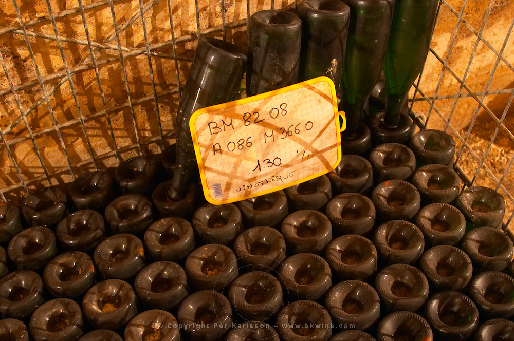 The Vinotheque (wine library) with small numbers of older bottles stacked stored upside down on their heads 130 bottles of the 1982 vintage Brut Millesime at Champagne Deutz in Ay, Vallee de la Marne, Champagne, Marne, Ardennes, France