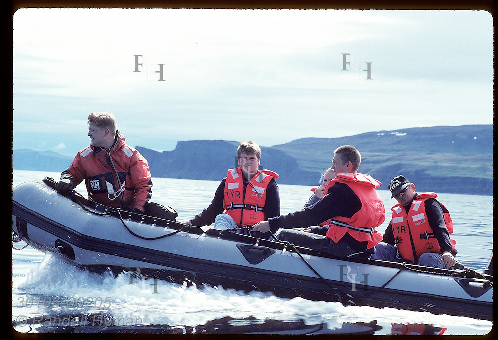Crew and cadets from coast guard ship Tyr ride in dinghy on an excursion to Hornbjarg in summer Iceland