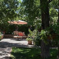 The Chavez-Baca backyard stretches two houses and includes fruit and vegetable plants as well as areas for the family to relax and cook over a barbecue pit.