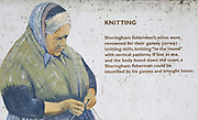 Picture and information about traditional knitting on sea wall, Sheringham, Norfolk, England, UK