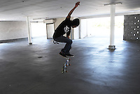 Skateboarder Ramon Camberos, 21, practices his moves on Sunday in an empty parking structure at the corner of Lincoln and Clay Street in Salinas.