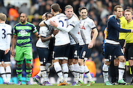 Danny Rose of Tottenham Hotspur is hugged by Kevin Wimmer of Tottenham Hotspur and Toby Alderweireld of Tottenham Hotspur  after the final whistle. Barclays Premier league match, Tottenham Hotspur v Swansea city at White Hart Lane in London on Sunday 28th February 2016.<br /> pic by John Patrick Fletcher, Andrew Orchard sports photography.
