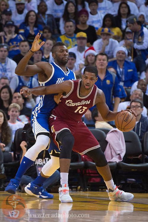 December 25, 2015; Oakland, CA, USA; Cleveland Cavaliers center Tristan Thompson (13) dribbles against Golden State Warriors center Festus Ezeli (31) during the third quarter in a NBA basketball game on Christmas at Oracle Arena. The Warriors defeated the Cavaliers 89-83.