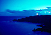 Lizard Point Lighthouse in Cornwall, England at dusk.