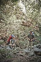 Backpackers take a break on the Pine Ridge Trail, Big Sur, California.