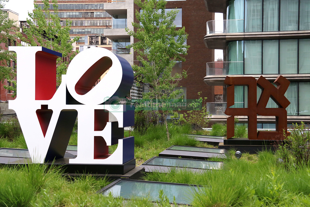 May 12, 2019 - New York City, New York, U.S. - Artist Robert Indiana's pop art 'Love' and Hebrew (ahava) sculptures on display along the High Line. The works can be seen at  Kasmin Galleries rooftop garden.  There are three sculptures with the word 'love', one in Spanish 'amor' and one in Hebrew (ahava) and one in English  (Credit Image: © Nancy Kaszerman/ZUMA Wire)