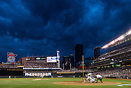 Ryan Doumit #9 of the Minnesota Twins bats under heavy blue clouds during a game against the Milwaukee Brewers on May 29, 2013 at Target Field in Minneapolis, Minnesota.  The Twins defeated the Brewers 4 to 1.  Photo: Ben Krause