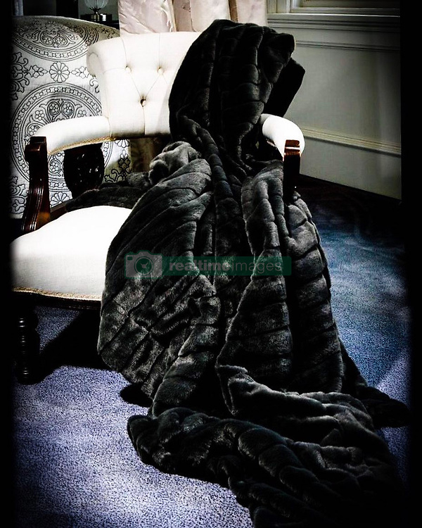 """Catherine Zeta Jones releases a photo on Instagram with the following caption: """"The Gracie Faux Fur Throw. Perfect accent for any room. @casazetajones"""". Photo Credit: Instagram *** No USA Distribution *** For Editorial Use Only *** Not to be Published in Books or Photo Books ***  Please note: Fees charged by the agency are for the agency's services only, and do not, nor are they intended to, convey to the user any ownership of Copyright or License in the material. The agency does not claim any ownership including but not limited to Copyright or License in the attached material. By publishing this material you expressly agree to indemnify and to hold the agency and its directors, shareholders and employees harmless from any loss, claims, damages, demands, expenses (including legal fees), or any causes of action or allegation against the agency arising out of or connected in any way with publication of the material."""