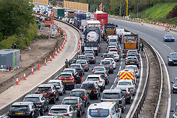 © Licensed to London News Pictures. 07/05/2021. Slough, UK. Traffic at a standstill following a serious collision between a motorcycle and a car on the M4 motorway westbound between junction 5 and junction 6 causing major delays to Friday rush-hour traffic. The stretch of motorway is currently being converted into a smart motorway with major roadworks due to be completed in 2022. Photo credit: Peter Manning/LNP