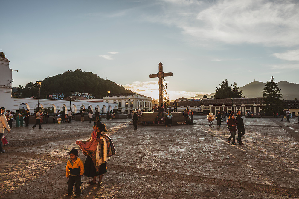 San Cristobal de las Casas, Mexico - November 18, 2014: People walk in the square outside the cathedral at sunset in San Cristóbal de las Casas, Chiapas, Mexico.