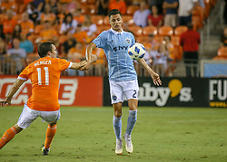 August 4, 2018 - Houston, TX, U.S. - HOUSTON, TX - AUGUST 04:  Sporting Kansas City forward Daniel Salloi (20) traps the ball and keeps it away from Houston Dynamo forward Andrew Wenger (11) during the soccer match between Sporting Kansas City and Houston Dynamo on August 4, 2018 at BBVA Compass Stadium in Houston, Texas.  (Photo by Leslie Plaza Johnson/Icon Sportswire) (Credit Image: © Leslie Plaza Johnson/Icon SMI via ZUMA Press)