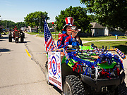 04 JULY 2020 - RUNNELLS, IOWA: Young people on an ATV ride in the 4th of July tractor parade in Runnells, a small community about 25 miles from Des Moines. Most of the Independence Day parades in central Iowa were cancelled because of the COVID-19 (Coronavirus) pandemic. People in Runnells made the decision to go ahead with their parade, the first 4th of July parade in the town in recent memory. Most of the people in the parade were farmers, who drove their tractors through the town.    PHOTO BY JACK KURTZ