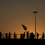 Fluminense fans walk from the Maracana Metro station to the stadium as the sun sets before the Fluminense V Sao Paulo, Futebol Brasileirao  League match at the Jornalista Mário Filho Stadium, Rio de Janeiro,  Brazil. 29th August 2010. Photo Tim Clayton.