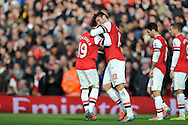 Arsenal's Oliver Giroud celebrates after he scores his second goal with Arsenal's Santi Cazorla during Barclays Premier League , Arsenal v Sunderland at the Emirates Stadium in London, England on Saturday 22nd Feb 2014.<br /> pic by John Fletcher, Andrew Orchard sports photography.