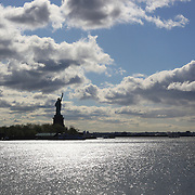 The Statue of Liberty on Liberty Island, New York Harbor viewed from Liberty State Park, New Jersey. New York, USA. 27th April 2012. Photo Tim Clayton
