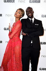 Jourdan Dunn (left) receives the Entrepeneur Award from Stormzy (right) in the press room at the Glamour Women of the Year Awards 2017, Berkeley Square Gardens, London.