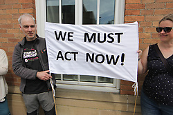 May 22, 2019 - Derby, Derbyshire, United Kingdom - Activists are seen holding a banner saying We Must Act Now during the demonstration..Extinction Rebellion group activists held a protest against climate change in Derby. (Credit Image: © Ben Booth/SOPA Images via ZUMA Wire)