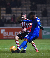 Lincoln City's Tom Pett closes down a clearance from Morecambe's Jordan Cranston<br /> <br /> Photographer Andrew Vaughan/CameraSport<br /> <br /> The EFL Sky Bet League Two - Saturday 15th December 2018 - Lincoln City v Morecambe - Sincil Bank - Lincoln<br /> <br /> World Copyright © 2018 CameraSport. All rights reserved. 43 Linden Ave. Countesthorpe. Leicester. England. LE8 5PG - Tel: +44 (0) 116 277 4147 - admin@camerasport.com - www.camerasport.com