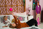 Haley Berg, 15, and her sister Rhyann, 2, play with a mini soccer ball in her bedroom in Celina, Texas on January 23, 2014. Berg, a freshman at Celina High School, began receiving attention from top collegiate soccer programs when she was 13 and has already committed to the University of Texas.