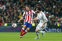 Real Madrid´s Daniel Carvajal (R) and Atletico de Madrid´s Koke during Spanish King´s Cup match at Santiago Bernabeu stadium in Madrid, Spain. January 15, 2015. (ALTERPHOTOS/Victor Blanco)