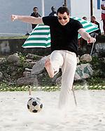 John Travolta playing beach soccer
