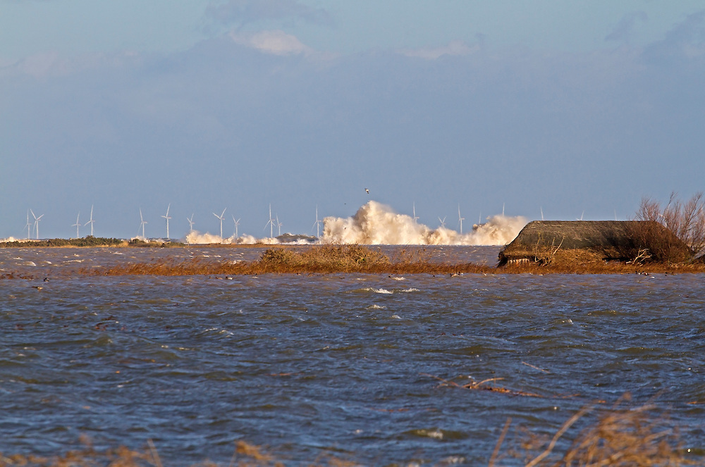 Floods of  6 12 2013 due to tidal surge, waves crashing against remains of  shingle sea defences with partially submerged hide, Cley next the sea,  Norfolk UK