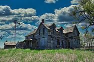 This abandon farmhouse is all that remains of the early 1900's small farm town of Pollard, Kansas.