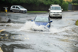 © Licensed to London News Pictures; 19/08/2020; Bristol, UK.Traffic drives through a flooded road on Henbury Road as the west of the country faces two days of heavy rain as Storm Ellen arrives in the UK. Photo credit: Simon Chapman/LNP.