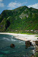 Philippines, Batanes. Beautifully situated Chavayan villages, Sabtang Island.