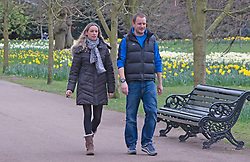© Licensed to London News Pictures 16/03/2021. Greenwich, UK. People walking in the park. Spring Daffodils at Greenwich Park in London today as the Met Office forecast for the next few days is sunshine with some rain across the UK. Photo credit:Grant Falvey/LNP