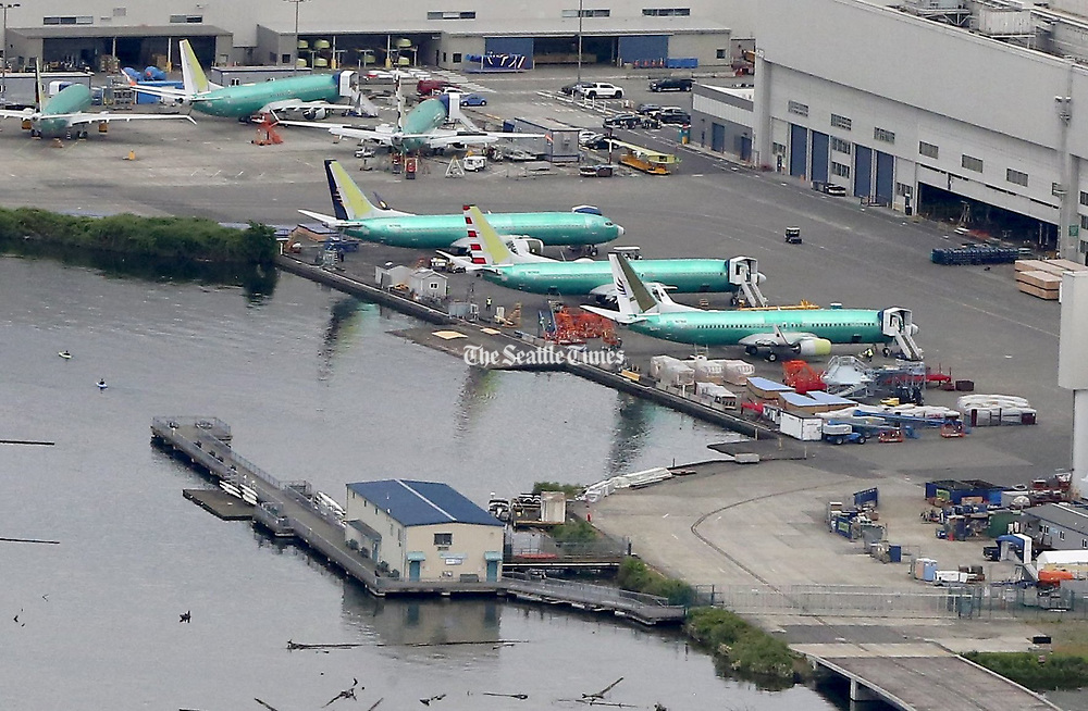 Unfinished Boeing 737 aircraft were parked outside the factory at the south end of Lake Washington in May. Boeing said Wednesday it is making progress in recovering its scheduled pace of deliveries. (Greg Gilbert / The Seattle Times)