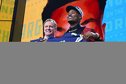 April 26, 2018 - Arlington, TX, U.S. - ARLINGTON, TX - APRIL 26:  Derwin James holds up a jersey with Commissioner Roger Goodell  after being chosen by the Los Angeles Chargers with the 17th pick during the first round at the 2018 NFL Draft at AT&T Statium on April 26, 2018 at AT&T Stadium in Arlington Texas.  (Photo by Rich Graessle/Icon Sportswire) (Credit Image: © Rich Graessle/Icon SMI via ZUMA Press)