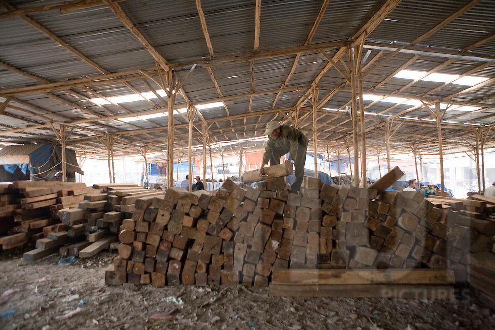 Stock of wood in a warehouse. Craft village of Dong Ky, specialized in wood furnitures manufacture. Vietnam, Asia
