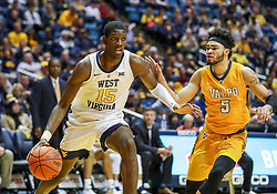 Nov 24, 2018; Morgantown, WV, USA; West Virginia Mountaineers forward Lamont West (15) drives baseline past Valparaiso Crusaders guard Markus Golder (5) during the second half at WVU Coliseum. Mandatory Credit: Ben Queen-USA TODAY Sports