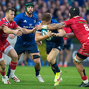 DUBLIN, IRELAND: October 16:  Garry Ringrose #13 of Leinster defended by Blade Thomson #8 of Scarlets and Gareth Davies #9 of Scarlets during the Leinster V Scarlets, United Rugby Championship match at RDS Arena on October 16th, 2021 in Dublin, Ireland. (Photo by Tim Clayton/Corbis via Getty Images)