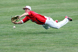 06 April 2013:  Centerfielder Chad Hinshaw runs in to attempt a catch of a short hit fly ball during an NCAA division 1 Missouri Valley Conference (MVC) Baseball game between the Missouri State Bears and the Illinois State Redbirds in Duffy Bass Field, Normal IL