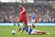 Charlton Athletic Midfielder, Jake Forster-Caskey (19) beats Portsmouth Midfielder, Connor Ronan (14) to the ball during the EFL Sky Bet League 1 match between Portsmouth and Charlton Athletic at Fratton Park, Portsmouth, England on 21 April 2018. Picture by Adam Rivers.