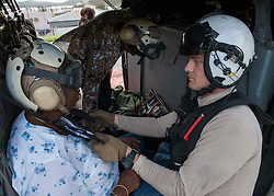 170909-N-NM806-495 <br /> ST. THOMAS, U.S. Virgin Islands (Sept. 9, 2017) Naval Aircrewman (Helicopter) 2nd Class Nicholas Glass, assigned to Helicopter Sea Combat Squadron (HSC 22) aboard the amphibious assault ship USS Wasp (LHD 1), prepares a resident for evacuation as part of first response efforts to the U.S. Virgin Islands in the wake of Hurricane Irma. The Department of Defense is supporting the Federal Emergency Management Agency, the lead federal agency, in helping those affected by Hurricane Irma to minimize suffering and is one component of the overall whole-of-government response effort. (U.S. Navy photo by Mass Communication Specialist Seaman Taylor King/Released)
