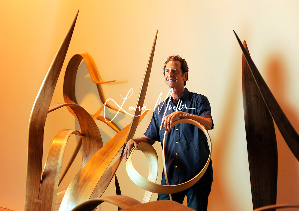 Charlotte Observer Only - Rick Lazes, whose studio is at the NC Music Factory, has been creating sculptures for more than 3 decades. His medium of choice is wood (walnut, cherry, maple, ash and poplar), which is steamed, and bent into organic forms.<br />     Several pieces from 'The World of Bending' series are on exhibition for the first time at The Andre Christine Gallery & Sculpture Garden in Mooresville.<br /> photo by Laura Mueller<br /> www.lauramuellerphotography.com