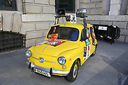 Small yellow SEAT car with megaphones and political posters, Madrid city centre, Spain