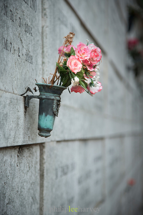 Flowers placed at a grave on. Cemetery of San Michele island, Venetian Lagoon, Venice Italy, Europe
