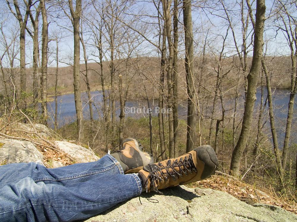 Feet of a hiker during a rest break.
