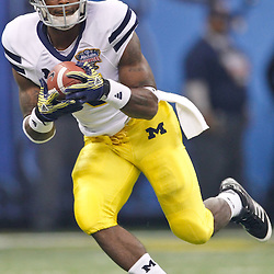 January 3, 2012; New Orleans, LA, USA; Michigan Wolverines running back Michael Cox (15) against the Virginia Tech Hokies during the Sugar Bowl at the Mercedes-Benz Superdome. Michigan defeated Virginia 23-20 in overtime. Mandatory Credit: Derick E. Hingle-US PRESSWIRE