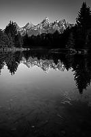 The Tetons are reflected at sunrise in Grand Teton National Park, Jackson Hole, Wyoming.
