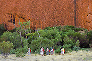 Tourists at the base of Ayers Rock, Uluru, Red Centre, Australia