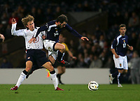 Photo: Andrew Unwin.<br />Scotland v USA. International Challenge. 12/11/2005.<br />Scotland's James McFadden (C) hops past the USA's Brian Carroll (L).