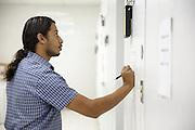 Cold store assistant manager Eddy Godoy records fridge temperatures at the PAI (Programa Ampliado de Inmunizaciones) offices in Tegucigalpa, Honduras, on Wednesday April 24, 2013..