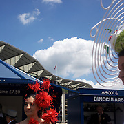 Ladies arrive wearing hats during the race meeting at Royal Ascot Race Course. Royal Ascot is one of the most famous race meetings in the world, frequented by Royalty and punters from the high end of society to the normal everyday working class. Royal Ascot 2009, Ascot, UK, on Tuesday, June 16, 2009. Photo Tim Clayton.