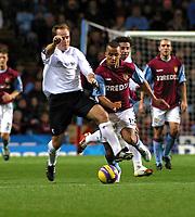 Photo: Dave Linney.<br />Aston Villa v Bolton Wanderers. The Barclays Premiership. 16/12/2006. Villa's Gabriel Agbonlahor(R) keeps a close eye on Henrik Pedrsen.